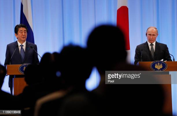 Russian President Vladimir Putin and Japanese Prime Minister Shinzo Abe attend their news conference at G20 leaders summit on June 29, 2019 in Osaka,...