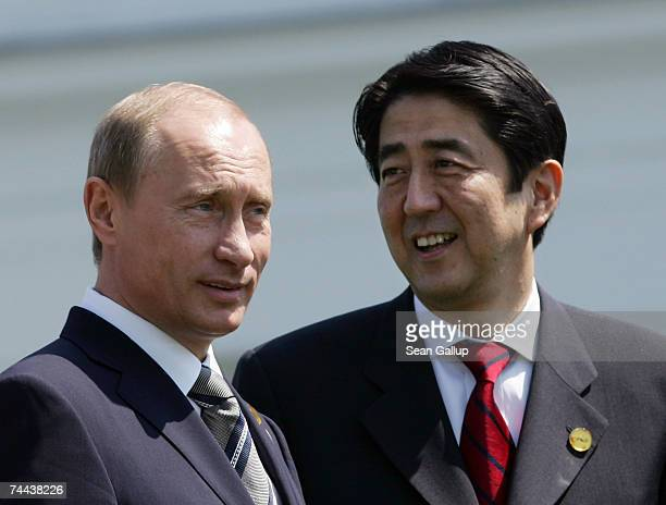 Russian President Vladimir Putin and Japanese Prime Minister Shinzo Abe arrive for a group photo at the summit of G8 leaders June 8 2007 in...