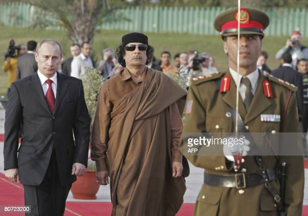 Russian President Vladimir Putin and Libyan leader Moamer Kadhafi attend a welcoming ceremony on April 16 2008 in Tripoli Putin arrived in Libya on...