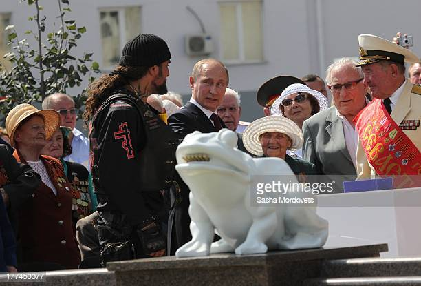 Russian President Vladimir Putin and Night Wolves Moscow Bikers club leader Alexander 'Khirurg' Zaldostanov attend the opening of the Barmaley...
