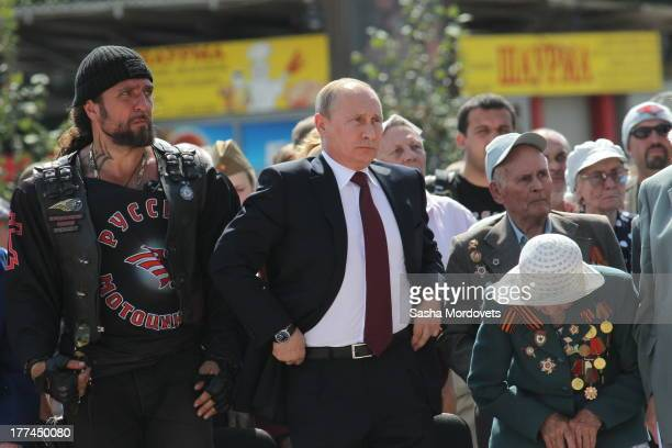 Russian President Vladimir Putin and Night Wolves Moscow Bikers club leader Alexander 'Khirurg' Zaldostanov at the opening of the Barmaley Fountain...