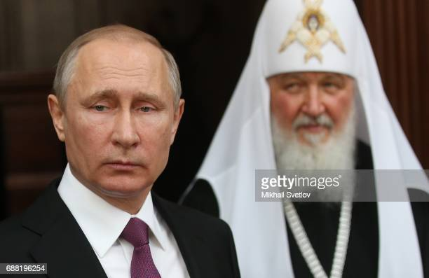 Russian President Vladimir Putin and Orthodox Patriarch Kirill seen while visiting the Sretensky Monastery on May 25 2017in Moscow Russia Newly built...