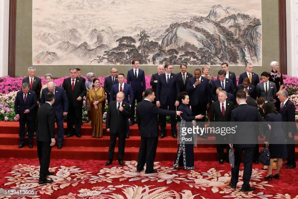 Russian President Vladimir Putin and other leaders arrive to attend a group photo session at a welcoming banquet for the Belt and Road Forum hosted...