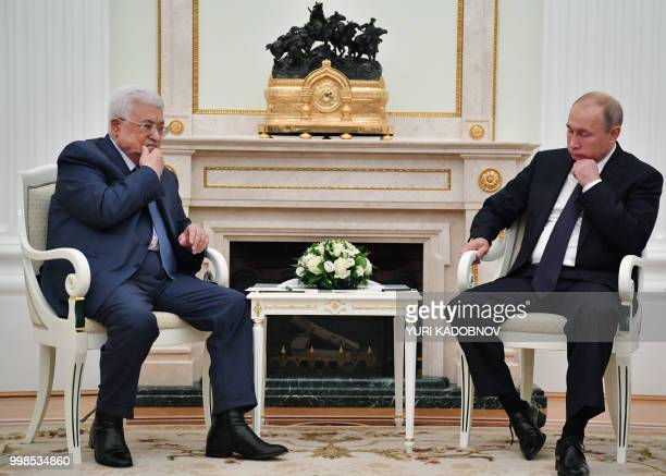 Russian President Vladimir Putin and Palestinian President Mahmud Abbas look on during their meeting at the Kremlin in Moscow on July 14 2018