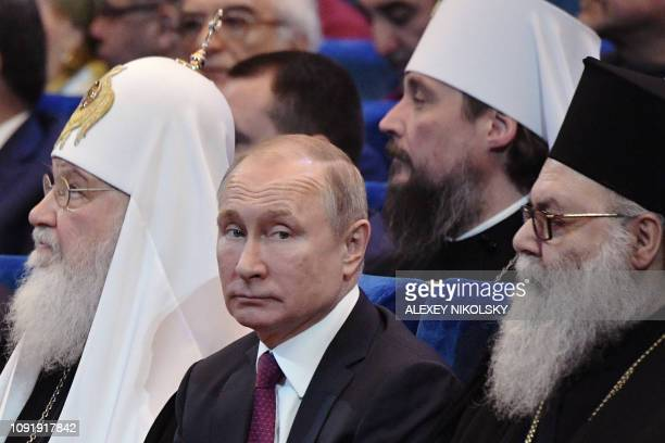 Russian President Vladimir Putin and Patriarch of Moscow and All Russia Kirill attend a concert marking the 10th anniversary of the patriarch's...
