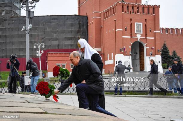 Russian President Vladimir Putin and Patriarch of Russia Kirill lay flowers at the monument of Minin and Pozharsky on the Red Square near the Kremlin...