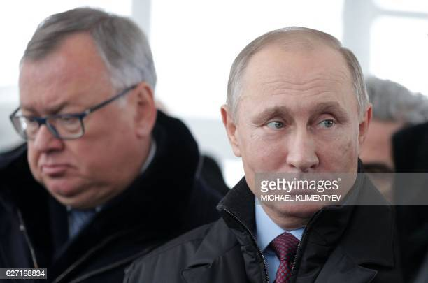 Russian President Vladimir Putin and President, chairman of the management board, VTB Bank, Andrei Kostin take part in the launching of the central...