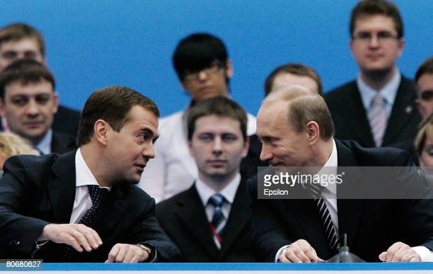 Russian President Vladimir Putin and Presidentelect Dmitry Medvedev speak at the United Russia party congress on April 15 2008 in Moscow Russia Putin...