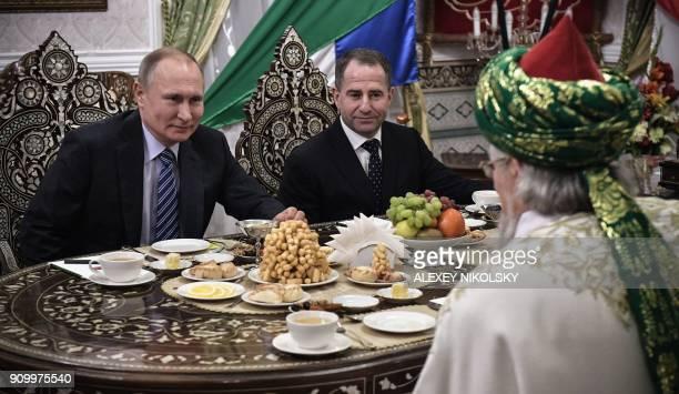 Russian President Vladimir Putin and presidential representative to the Volga Federal District Mikhail Babich talk to a Chief Mufti of Russia Talgat...