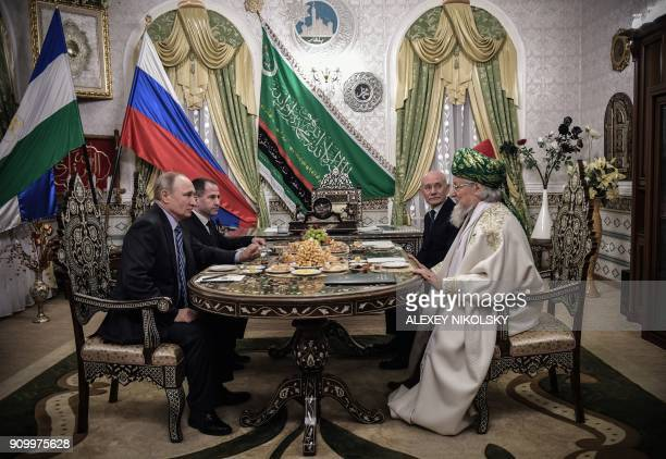 TOPSHOT Russian President Vladimir Putin and presidential representative to the Volga Federal District Mikhail Babich talk to Chief Mufti of Russia...