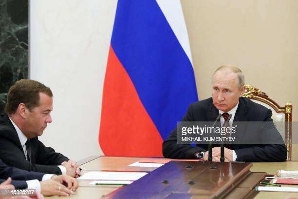 Russian President Vladimir Putin and Prime Minister Dmitry Medvedev attend the Security Council meeting at the Kremlin in Moscow on May 24 2019