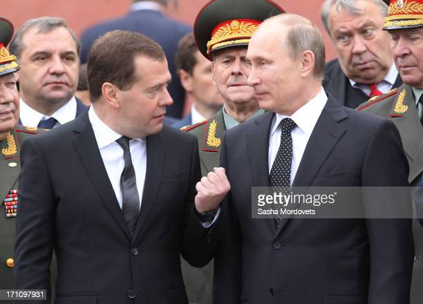Russian President Vladimir Putin and Prime Minister Dmitry Medvedev attend a wreath laying ceremony at the Tomb of the Unknown Soldier in Alexander...