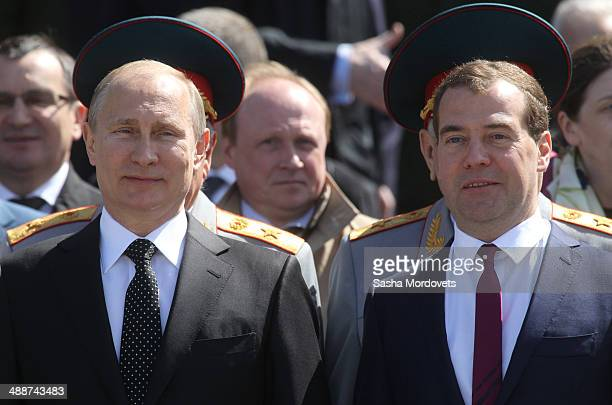 Russian President Vladimir Putin and Prime Minister Dmitry Medvedev attend a wreath laying ceremony at the Unknown soldier tomb near the Kremlin on...