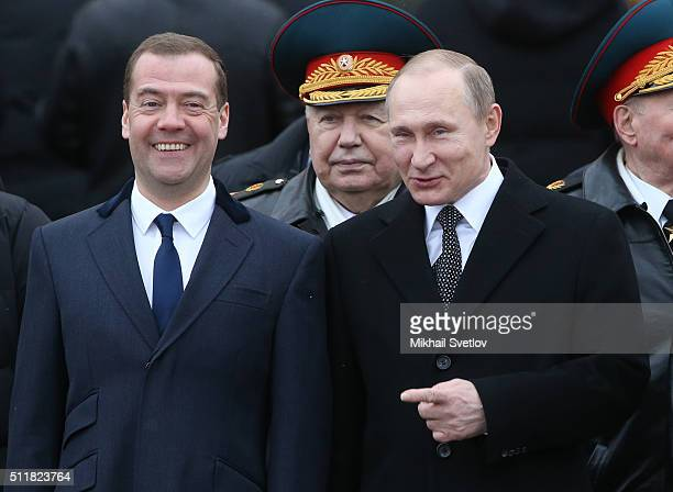 Russian President Vladimir Putin and Prime Minister Dmitry Medvedev during a wreath laying ceremony at the Unknown Soldier Tomb in front of the...