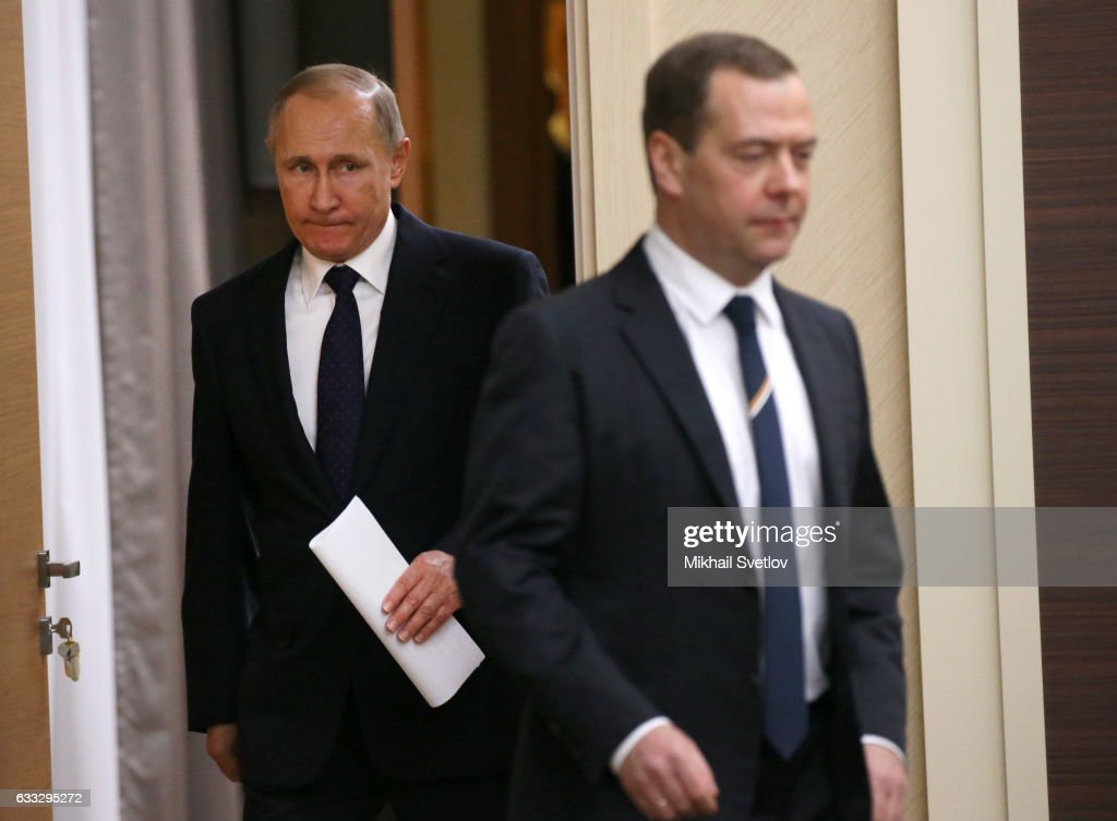 Russian President Vladimir Putin (L) and Prime Minister Dmitry Medvedev (R) enter the hall during his weekly meeting with ministers of the Government on February,1,2017 at Novo-Ogaryovo State Residence outside of Moscow, Russia.