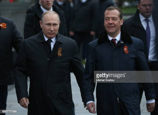 Russian President Vladimir Putin and Prime Minister Dmitry Medvedev attend the Victory Day military parade to celebrate the 72nd anniversary of the...