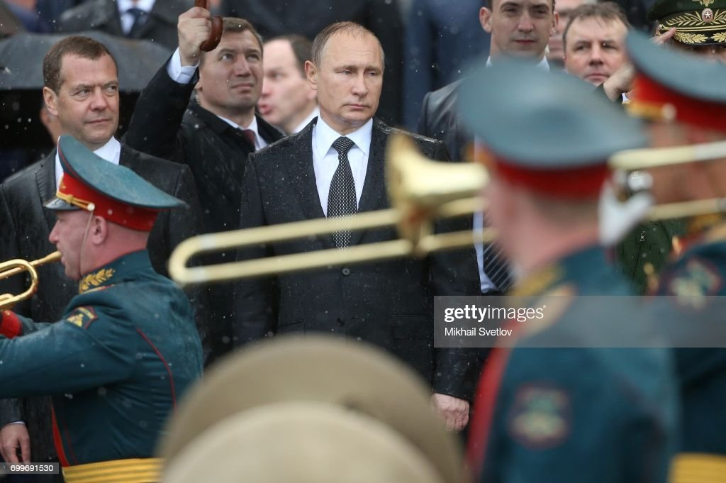 Russian President Vladimir Putin (C) and Prime Minister Dmitry Medvedev (L) attend military parade during the wreath laying ceremony at the Unknown Soldier's Tomb at Alexander Garden near the Kremlin on June 22, 2017 in Moscow, Russia. Today Russians are marking the anniversary of the 1941 German Nazi Army invasion into the Soviet Union.