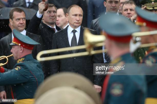 Russian President Vladimir Putin and Prime Minister Dmitry Medvedev attend military parade during the wreath laying ceremony at the Unknown Soldier's...