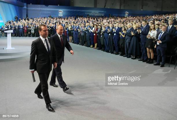 Russian President Vladimir Putin and Prime Minister Dmitry Medvedev enter the hall during the XVII Congress of the United Russia Party on December 23...