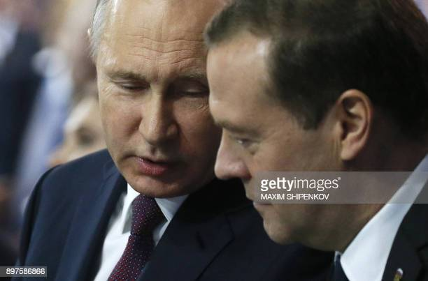 Russian President Vladimir Putin and Prime Minister Dmitry Medvedev speak as they attend the United Russia Party's 17th convention in Moscow on...