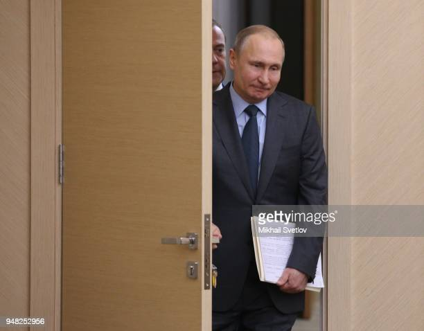 Russian President Vladimir Putin and Prime Minister Dmitry Medvedev enter the hall during their weekly meeting with ministers of Russian Governmnet...