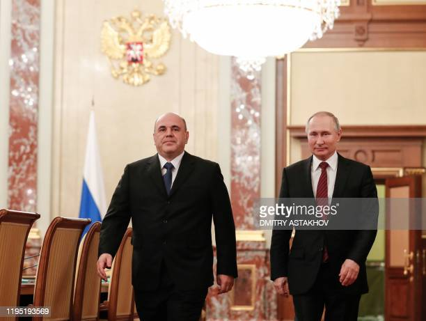 Russian President Vladimir Putin and Prime Minister Mikhail Mishustin arrive to meet with members of the new government in Moscow on January 21 2020