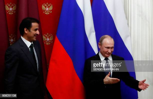 Russian President Vladimir Putin and Qatar's Emir Sheikh Tamim bin Hamad alThani attend a signing ceremony following a meeting at the Kremlin in...