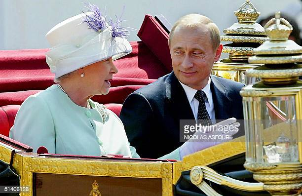 Russian President Vladimir Putin and Queen leave in an open carriage after the president was given a ceremonial welcome on Horse Guards Parade, by...