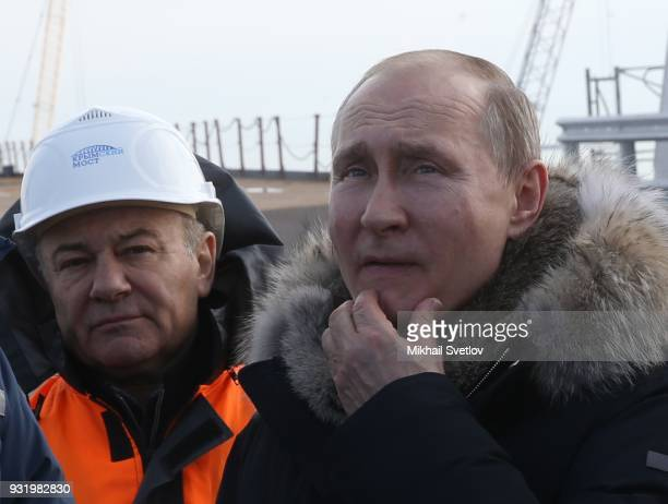 Russian President Vladimir Putin and Russian billionaire and businessman Arkady Rotenberg visit the construction site for the Crimean bridge which is...