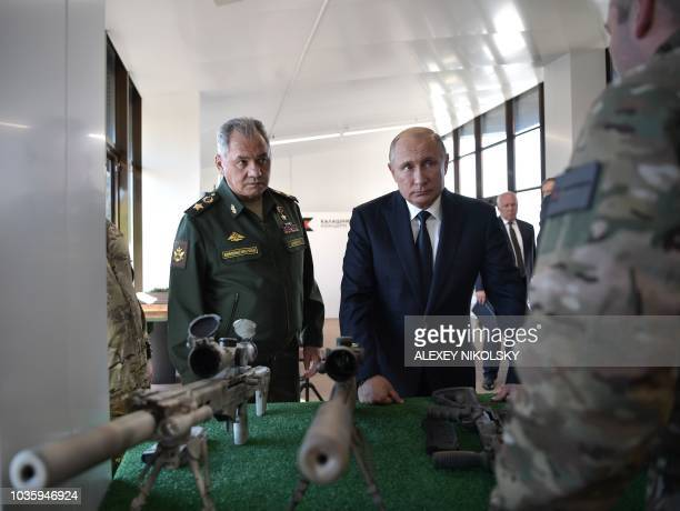 Russian President Vladimir Putin and Russian Defence Minister Sergei Shoigu visit the military Patriot Park in Kubinka outside Moscow on September 19...