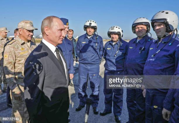Russian President Vladimir Putin and Russian Defence Minister Sergei Shoigu meet with Russian air force pilots during their visit to the Russian air...