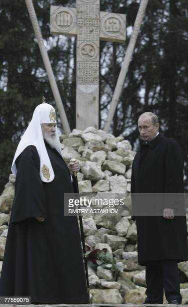 Russian President Vladimir Putin and Russian Orthodox Patriarch Alexy II attend a memorial church service in Butovo outside Moscow 30 October 2007...