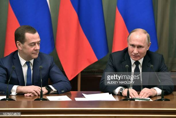 Russian President Vladimir Putin and Russian Prime Minister Dmitry Medvedev attend a meeting with the Government in Moscow on December 26 2018