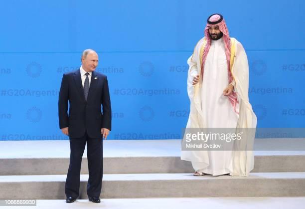 Russian President Vladimir Putin and Saudi Arabia's Crown Prince Mohammad bin Salman Al Saud attend the G20 Summit's Plenary Meeting on November 30...