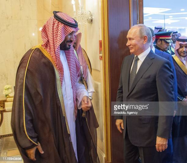 Russian President Vladimir Putin and Saudi Arabia's King Salman bin Abdulaziz alSaud meet at the AlYamamah Palace in Riyadh Saudi Arabia on October...