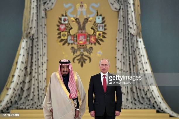 Russian President Vladimir Putin and Saudi Arabia's King Salman bin Abdulaziz Al Saud attend a welcoming ceremony ahead of their talks at the Kremlin...