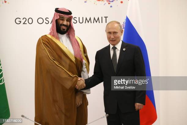 Russian President Vladimir Putin and Saudi Arabia's Prince and Defence Minister Mohammad bin Salman al Saud attend their bilateral talks at the G20...