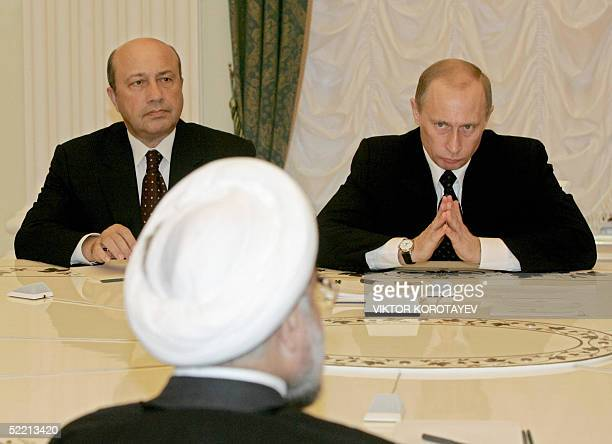 Russian President Vladimir Putin and Security Council Secretary Igor Ivanov listen to Iran's top nuclear official Hassan Rowhani during their meeting...