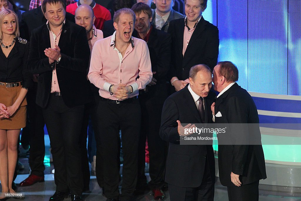 Russian President Vladimir Putin (2R) and showman Alexander Maslyakov (R) attend the opening of the International Youth Comic Club on the television show KVN at the new building 'Planet KVN' on April 1, 2013 in Moscow, Russia. KVN is a popular comedic talent show for student teams, and has been aired on national TV since 1961.