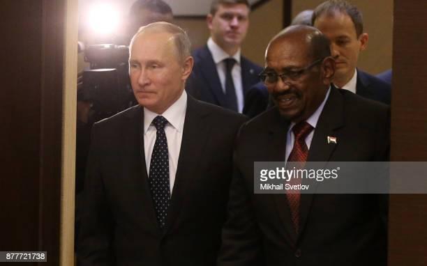 Russian President Vladimir Putin and Sudanese President Omar al-Bashir during their meeting at Black Sea resort on November 2017 in Sochi,...