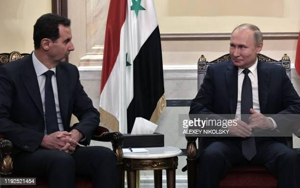 Russian President Vladimir Putin and Syrian President Bashar al-Assad hold a meeting in Damascus on January 7, 2020. - Putin met his Syrian...