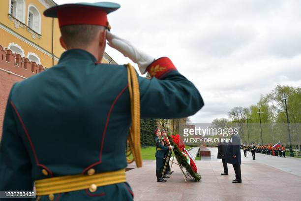 Russian President Vladimir Putin and Tajikistan's President Emomali Rakhmon attend a wreath-laying ceremony at the Tomb of the Unknown Soldier after...