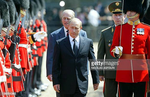 Russian President Vladimir Putin and The Duke of Edinburgh review the honour guards during an official meeting ceremony at Horse Guards in London, 24...
