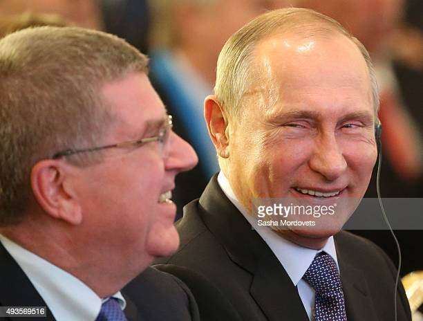 Russian President Vladimir Putin and Thomas Bach attend the 2015 World Olympians Forum on October 21 2015 in Moscow Russia