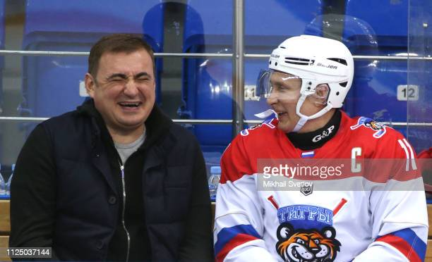 Russian President Vladimir Putin and Tula oblast Governor Alexei Dyumin laugh during an ice hockey match at Shaiba Arena on February 15 2019 in Sochi...