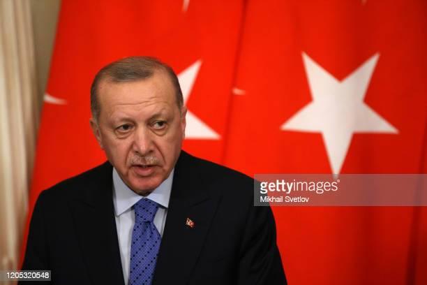 Russian President Vladimir Putin and Turkish President Recep Tayyip Erdogan speak during their talks at the Kremlin on March 5, 2020 in Moscow,...