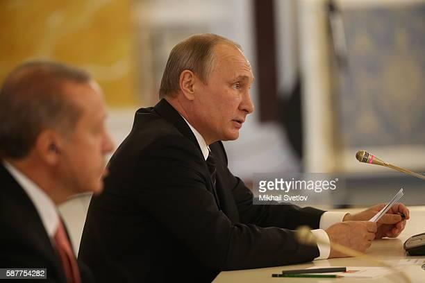 Russian President Vladimir Putin and Turkish President Recep Tayyip Erdogan attend a meeting in Konstantin Palace in Strenla on August 2016 in Saint...