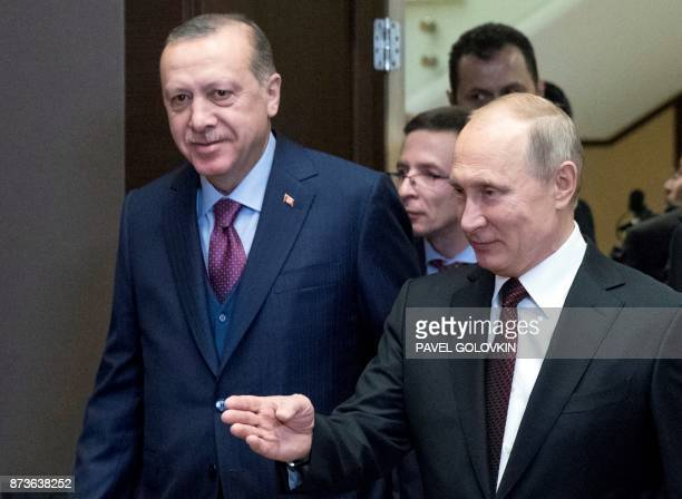 Russian President Vladimir Putin and Turkish President Recep Tayyip Erdogan arrive for their their meeting in the Bocharov Ruchei state residence in...