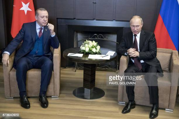 Russian President Vladimir Putin and Turkish President Recep Tayyip Erdogan are pictured during their meeting in the Bocharov Ruchei state residence...