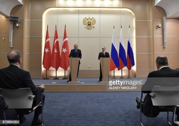 TOPSHOT Russian President Vladimir Putin and Turkish President Recep Tayyip Erdogan address a press conference at the Bocharov Ruchei state residence...